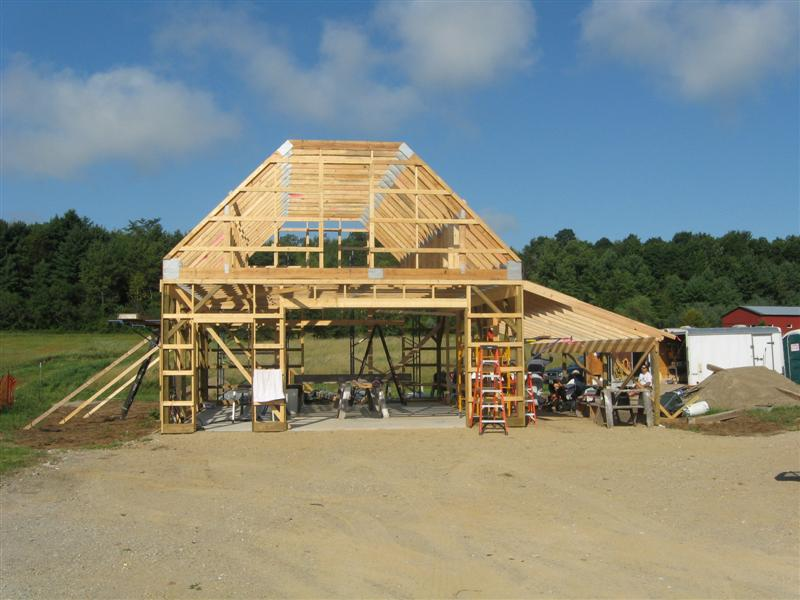 Attic trusses in this new barn will provide ample storage.