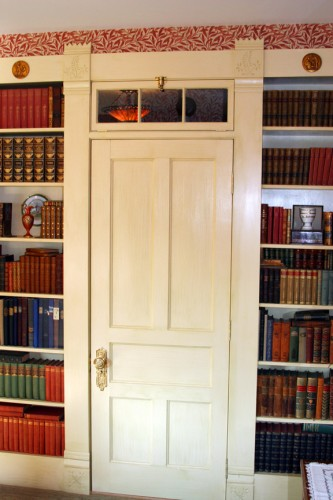 Flat panel door with flanking bookcases